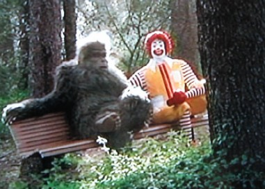 Bigfoot sitting on a bench with Ronald McDonald