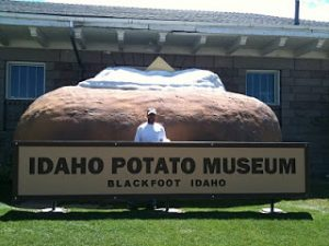 "Michael standing in front of a giant potato and sign reading, ""Idaho Potato Museum, Blackfoot Idaho"""