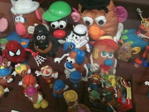 Numerous Mr. Potato Heads wearing different thematic costumes.