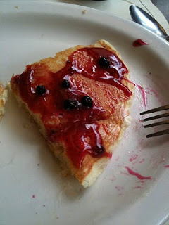 A piece of pancake smothered in huckleberry syrup.