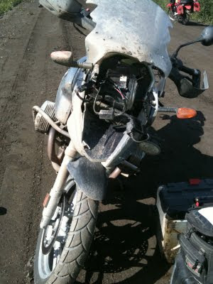 Front view of a motorcycle that is damaged