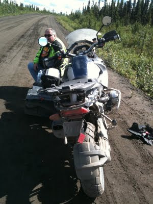 Chuck resting on the side of the road next to motorcycles