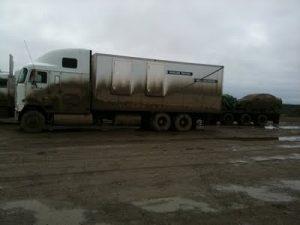 Semi truck covered in mud