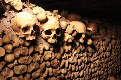 Skulls embedded in a wall in the catacombs