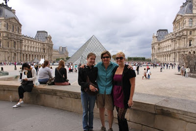 Linzy, Judy, Nikole standing outside of the Louvre