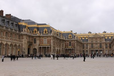A long line outside of the Palace of Versailles