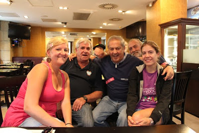Linzy and Nikole sitting with three men from the Basque rowing team