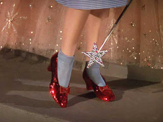 Dorothy clicking the heels of her ruby red slippers