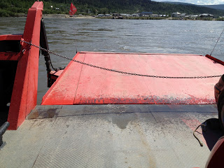 The back end of a red ferry