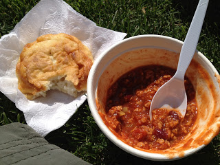 A bowl of chili with a piece of bannock on the side