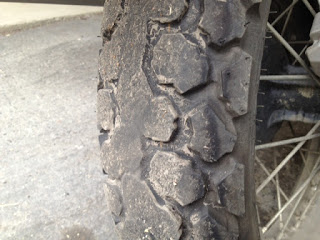 Motorcycle tire with worn down tread