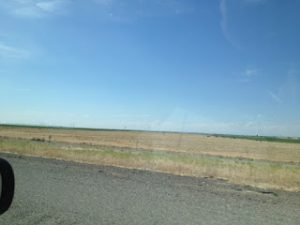 Vast empty expanse, just sky and land, nothing else in sight.
