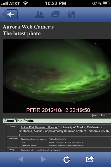 A phone screenshot of the Aurora Web Camera: The latest photo shows bright green in the sky