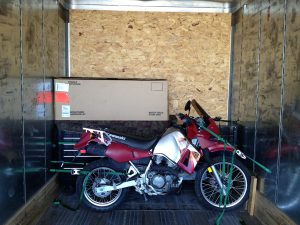 Image of motorcycle parked inside a moving van