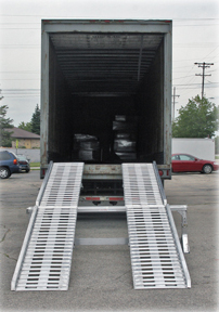 Image of a steep ramp into the back of a semi-truck