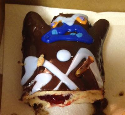 Image of a have-eaten doughnut