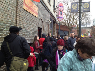 Image of a long line of people outside of Voodoo