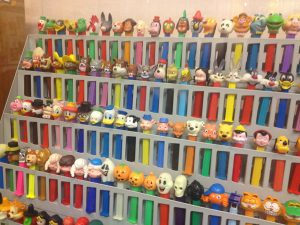 Image of shelf with countless PEZ dispensers