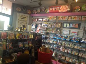 An image of the inside of the PEZ museum with PEZ dispensers filling shelves