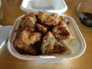 Image of fried artichokes in a Styrofoam container