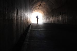 Image of man dancing in tunnel
