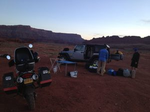 Image of Neal going through gear bags looking for stove