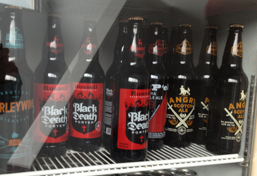 Image of Black Death Porter and Angry Scotch Ale bottles