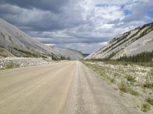 Image of a gravel road surrounded by gravel mountainsides