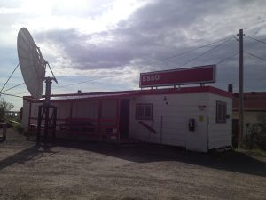 "Image of a very small and simple gas station with a sign reading, ""Esso"""