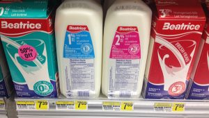 Image of two half gallons of milk on a shelf priced at $7.69 each