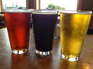 Image of a red beer (left), a dark beer (middle) and a light beer (right)