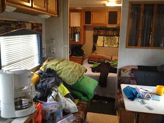 Image of the inside of a very messy trailer
