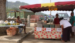 Image of a local outside market with a table with fresh eggs