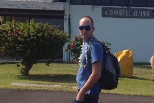 Image of a man (Ryan) wearing sunglasses and a backpack