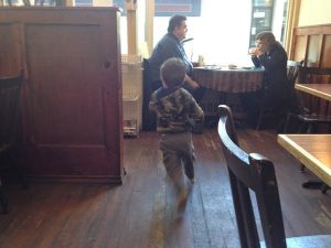 Image of a child running inside a coffee shop
