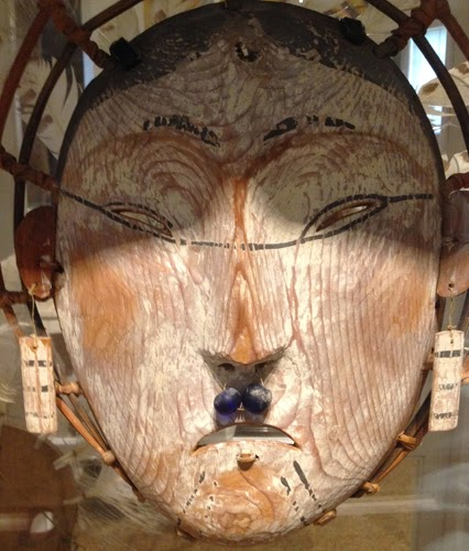 Image of a large wooden face