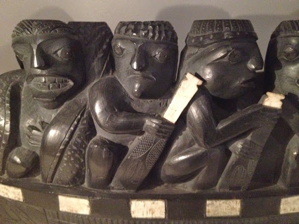 Image of a piece of carved art of several men who look like they are rowing