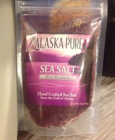"Image of a bag of purple salt with a label reading, ""Alaska Pure Sea Salt, Wild Blackberry, Hand Crafted from the Gulf of Alaska"""