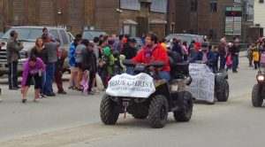 "Image of a man on a four-wheeler with a sign reading ""Jesus Christ of Latter Day Saints"""