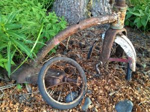 Image of a rust tricycle