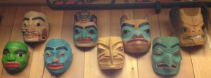 Image of several wooden, carved, colorful masks on display