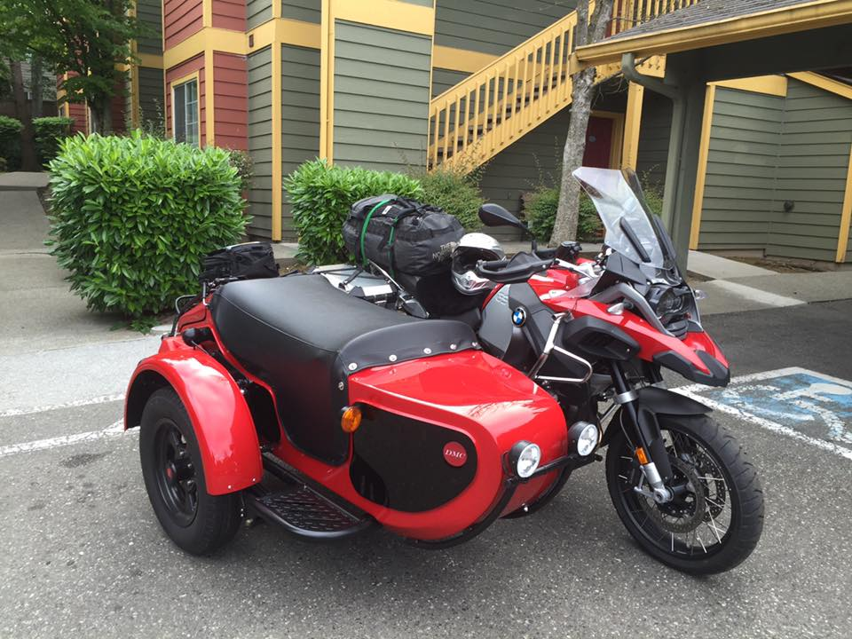 Image of a red motorcycle with a sidecar